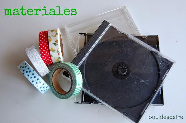 Diogeneras. Marco de fotos con caja de CD