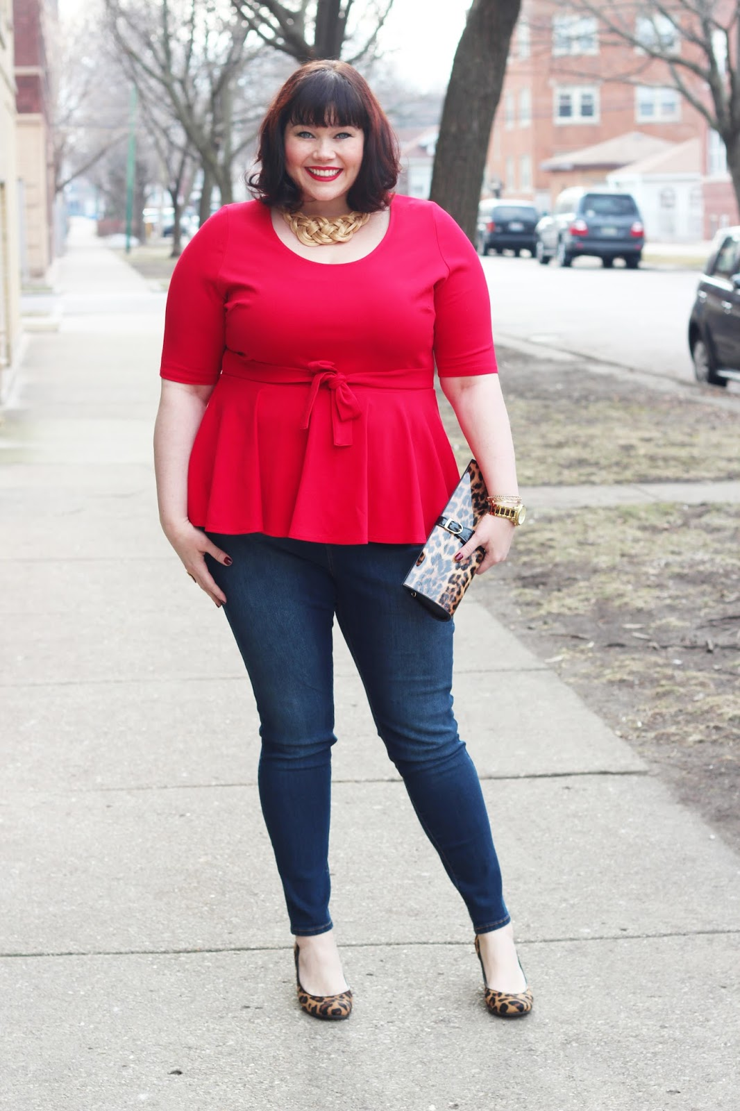 Plus size red peplum top and skinny jeans from Fashion to Figure on Plus Size blogger Amber from Style Plus Curves