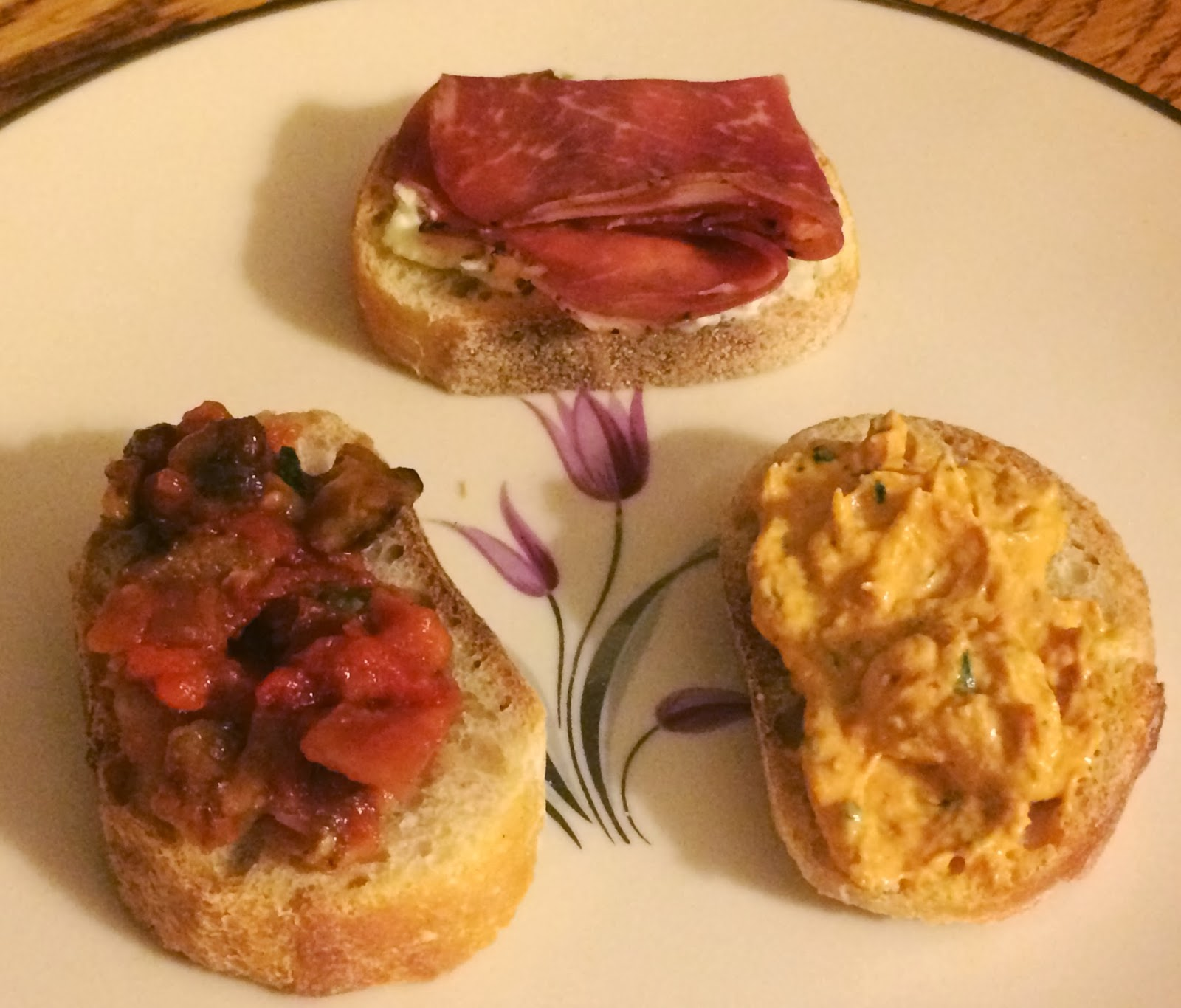Caponata, Roasted Red Pepper Spread, Garlic Goat Cheese Spread - on warm baguette slices