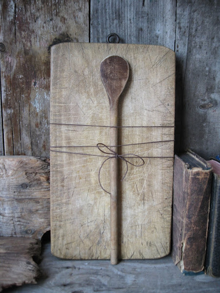 a very pretty old chopping board and spoon