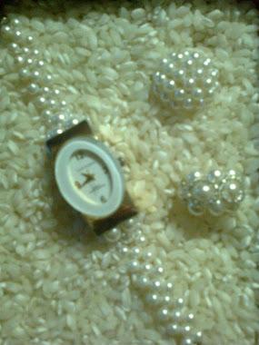 reloj y anillos