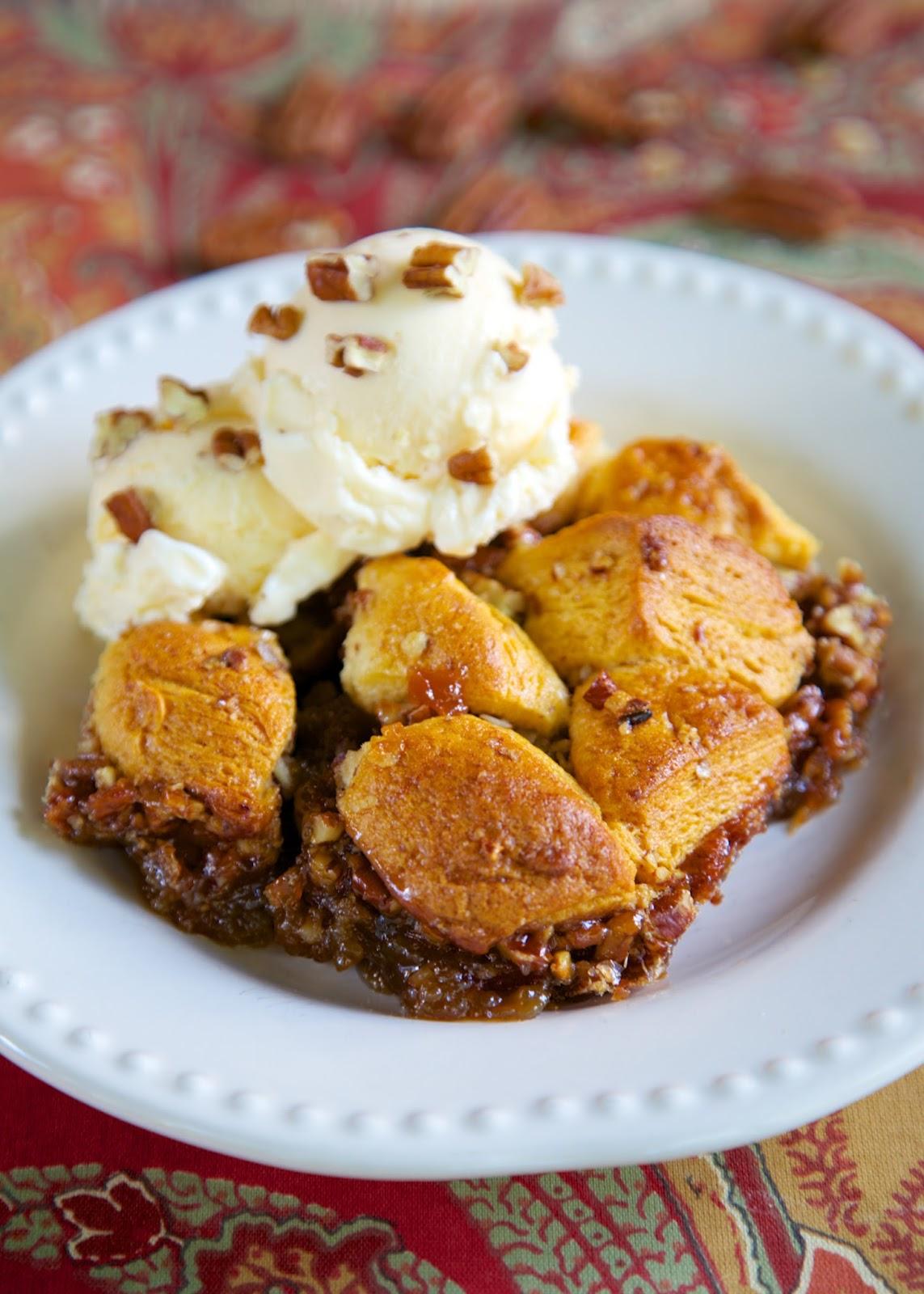 Pecan Pie Bubble Up - pecan pie filling tossed with biscuits - crazy good!! Serve warm with vanilla ice cream!