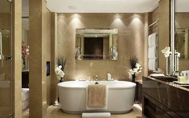 Luxury marble bathroom with white bathtub