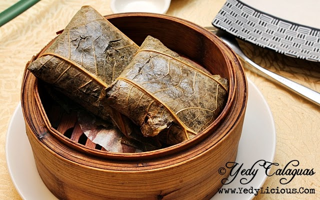 Crystal Jade Steamed Glutinous Rice with Conpoy wrapped in Lotus Leaf