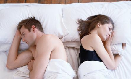 3 Foods That May Be Ruining Your Sex Life - man and woman sleeping in bed awake