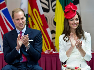 William and Kate, the Duke and Duchess of Cambridge, applaud during a citizenship ceremony Friday, July 1, 2011, in Gatineau, Canada.
