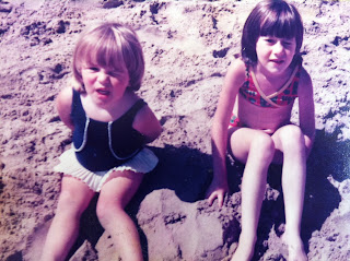 Me and my sister sitting on the beach