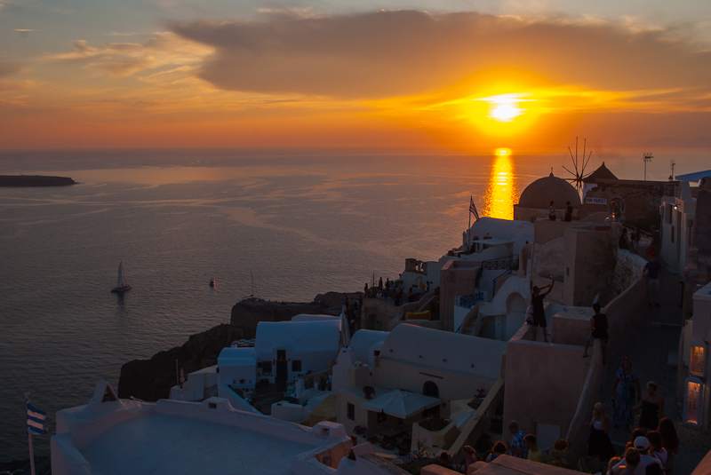 image of the famous summer sunset in oia santorini
