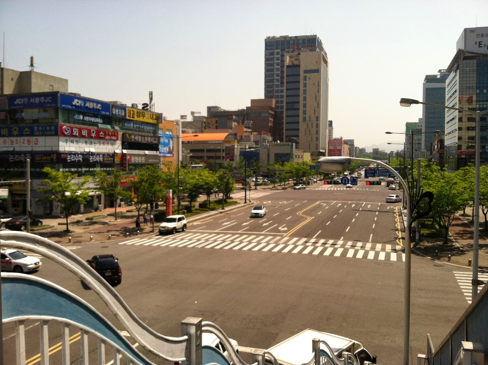 Picture of street in gwangju taken from pedestrian overpass
