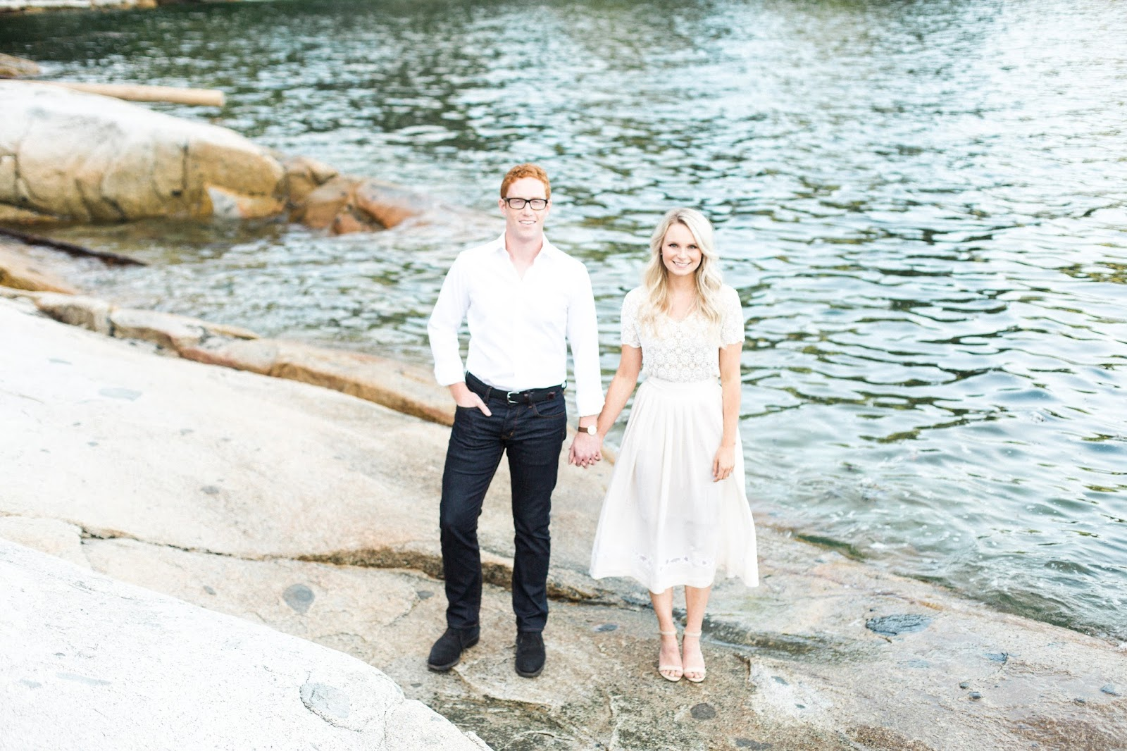engaged couple down by the waters edge