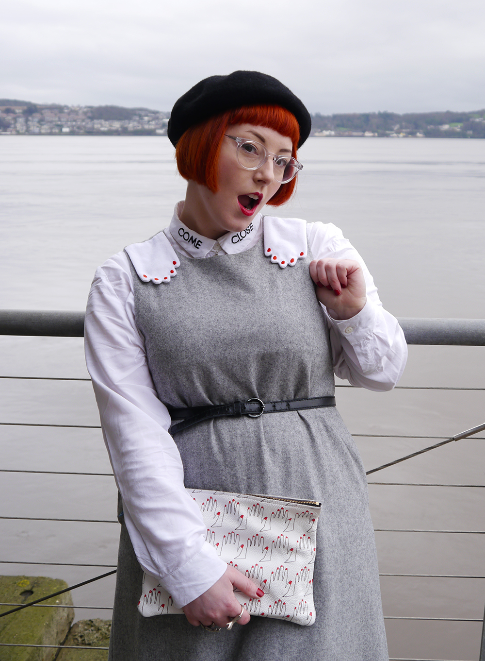 Scottish blogger, red head, ginger hair, pinafore, school style, The Whitepepper hand dress, white Monki come close shirt, black beret, clear Iolla glasses, hand print clutch bag, Falconwright printed leather clutch bag, Ted & Muffy black pointed boots, Cheap Frills best friend necklace, best withces, silver hand rings