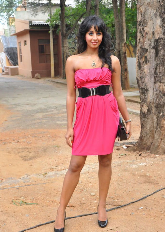 SANJANA GALRANI NEW HOT STILLS AT MUGGURU AUDIO LAUNCH unseen pics