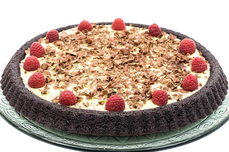 Triple chocolate cake with raspberry whole close