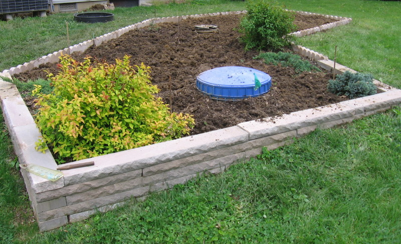Landscaping Over A Septic Tank : Anothercourse of limestone block was added to the terraced side