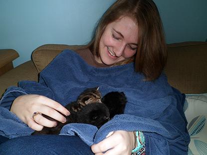 Charlotte cuddling kittens