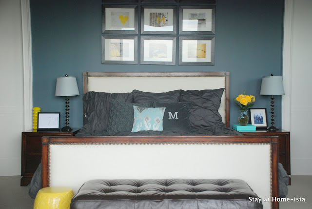 Charcoal grey bedroom with pops of yellow