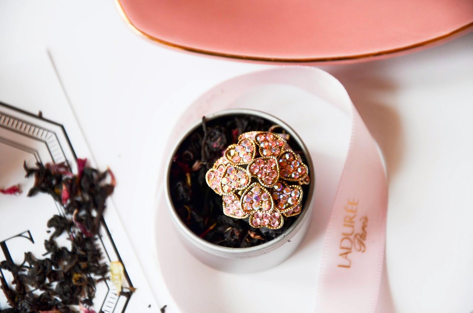 Sloane tea in heart shaped cup, pink macarons from laduree