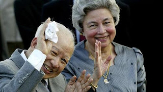 Cambodia's King Norodom Sihanouk and Queen Monineath wave at Phnom Penh airport, in Cambodia
