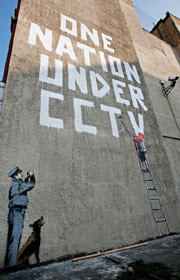 Street artist Banksy on surveillance © C. Gillon/Getty Images