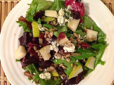 Pear, blue cheese, sunflower seed, and dried cranberry salad