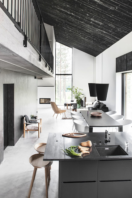 Modern neutral kitchen dining and living room grey black white tan concrete floor