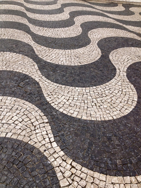 Cobblestone street patterns in Lisbon on Semi-Charmed Kind of Life