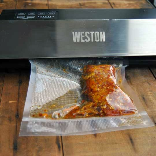 rub the salmon with the mixture evenly place into a vacuum sealer bag and use a vacuum sealer to seal allow to cure 24 hours in the - Weston Vacuum Sealer