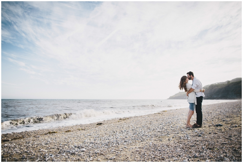 Couple kissing on the beach at Lyme Regis