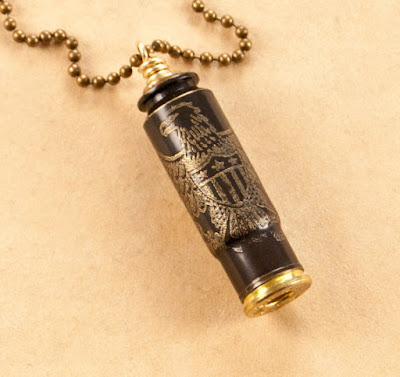 Etched bullet casing pendant with eagle motif from Dazzlez.