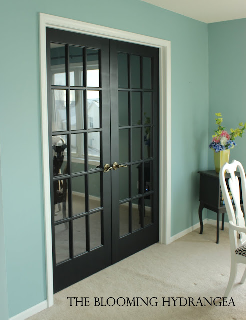 doors to her living room and painted them black i love how they came. Black Bedroom Furniture Sets. Home Design Ideas