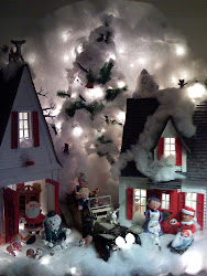 A Christmas Village I made out of cardboard strips and lots of Hot Glue.