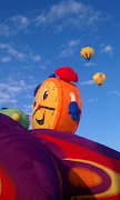 This brought to mind the actual possibility of taking vows on a balloon . (balloonfiesta jpg)