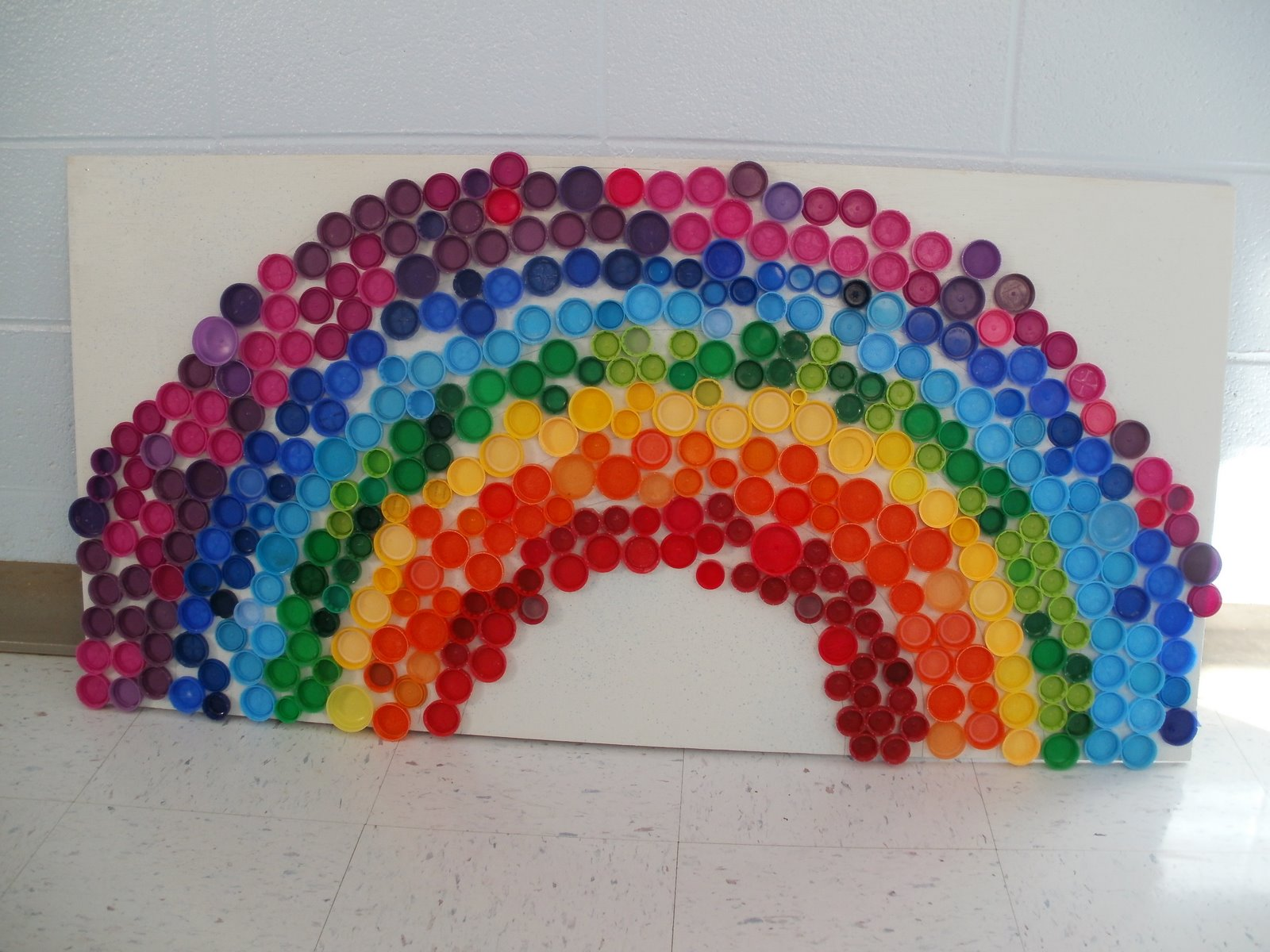 Mollie 39 s mom somewhere over the rainbow for Bottle top art projects