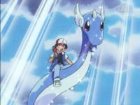 Ash montando a Dragonair