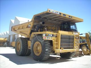 Gambar Mobil Dump Truck Dengan Merek Caterpillar