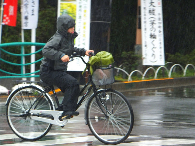Cycling in wet weather clothing in Tokyo