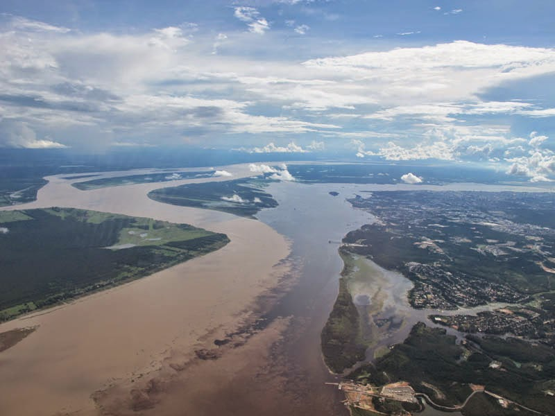 Confluence of the Rio Negro and the Rio Solimoes near Manaus, Brazil. - Here Are 12 Points In The World Where Major Bodies Of Water Join Together… And They're So Awesome.