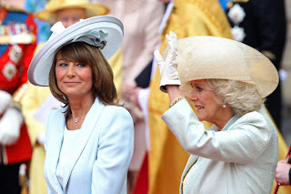 Carole Middleton smiles as Camilla, Duchess of Cornwall waves to the cheering crowds following the ceremony.