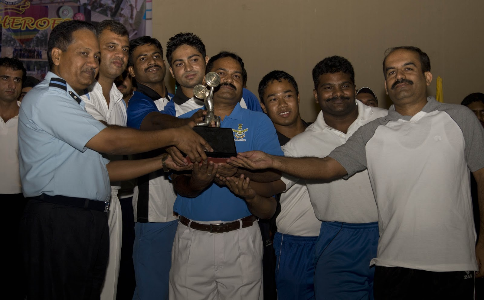 Cac claim air force weightlifting trophy sportswire cac team members receiving the air force weight lifting championship trophy from air cmde suresh singh aoc 3brd nvjuhfo Choice Image