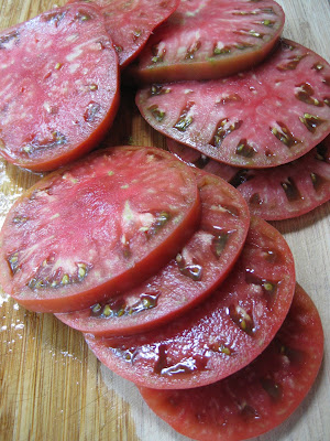 several slices of tomatoes on cutting board