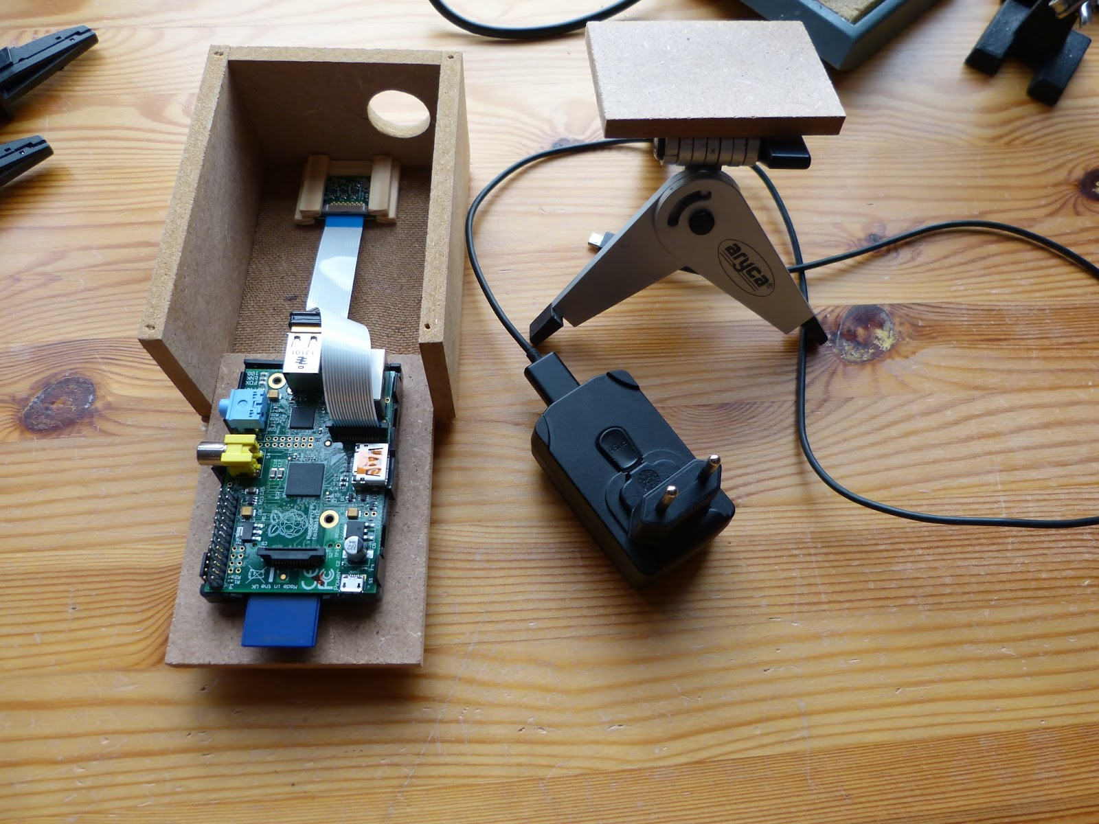 Raspberry Pi B and camera module in an MDF enclosure.