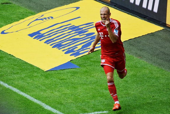 Bayern Munich player Arjen Robben celebrates after scoring a goal against Nürnberg