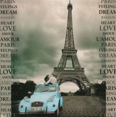 Pale blue 2CV beside the Eiffel Tower, with couple kissing