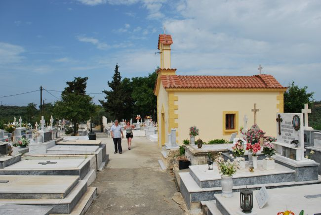 picture of cemetery with man and woman walking