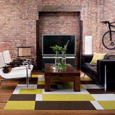 it is obvious the space with the fireplace and bright colored and bold patterned rug is the better design the space where everything - Emphasis Interior Design