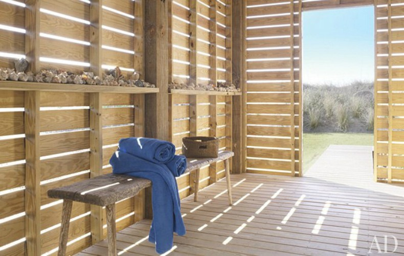 The breezeway made of slatted pine opens directly onto the dunes and makes for a lovely spot to kick off your sandals.