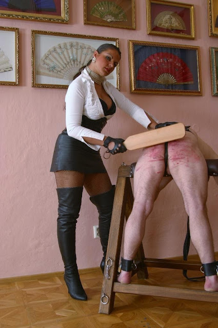 Femdom caning rituals
