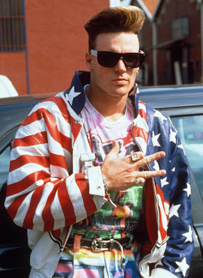 vanilla ice, justing beiber, piece sign, american flag coat, air brushed clothes, ray ban, haircut