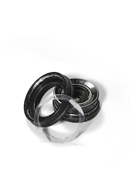 Plastic rings connected with thin double-sided tape...