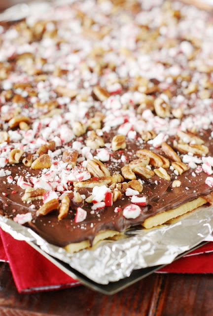 Peppermint Saltine Cracker Toffee  {aka ~ Peppermint Christmas Crack} - peppermint lovers, add this one to your Christmas baking list!   www.thekitchenismyplayground.com
